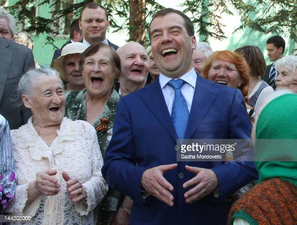 Russian Prime Minister Dmitry Medvedev meets with war and labor veterans at an assisted living facility on May 11 2012 in Tambov 450 kilometers south...