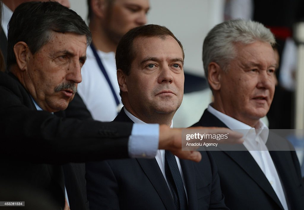Russian Prime Minister Dmitry Medvedev (C), Moscow Mayor Sergey Sobyanin (R) and ICF President Jose Perurena (L) attends the opening ceremony of Canoe Sprint World Championships (ICF) 2014 in Moscow, Russia on August 6, 2014.
