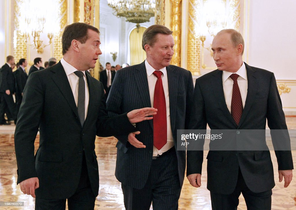 Russian Prime Minister Dmitry Medvedev (L), Presidential Chief of Staff Sergei Ivanov (C) and Russian President Vladimir Putin walk after the annual state of the nation address at the Kremlin in Moscow on December 12, 2012. In the first annual address to the nation of his new Kremlin term, Putin was expected to stake out Russia's strategic priorities at a time of unprecedented challenge to his rule.