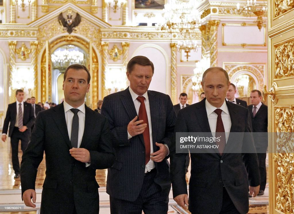 Russian Prime Minister Dmitry Medvedev (L), Presidential Chief of Staff Sergei Ivanov (C) and Russian President Vladimir Putin walk after the annual state of the nation address at the Kremlin in Moscow on December 12, 2012. In the first annual address to the nation of his new Kremlin term, Putin was expected to stake out Russia's strategic priorities at a time of unprecedented challenge to his rule. . AFP PHOTO / RIA NOVOSTI / POOL / DMITRY ASTAKHOV