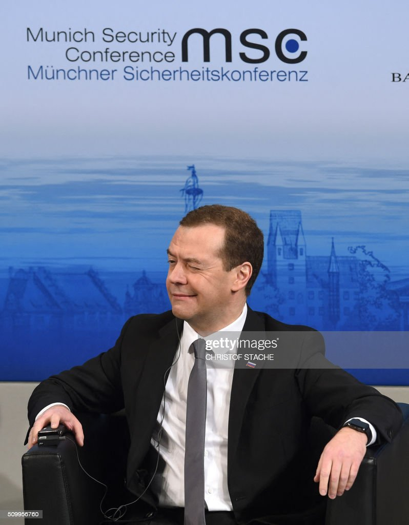 Russian Prime Minister Dmitry Medvedev reacts as he follows a speech at the panel of the second day of the 52nd Munich Security Conference (MSC) in Munich, southern Germany, on February 13, 2016. / AFP / Christof STACHE