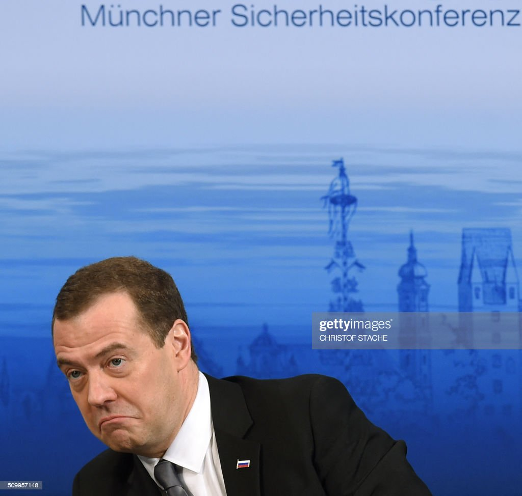 Russian Prime Minister Dmitry Medvedev reacts as he follows a speech during the second day of the 52nd Munich Security Conference (MSC) in Munich, southern Germany, on February 13, 2016. / AFP / Christof STACHE