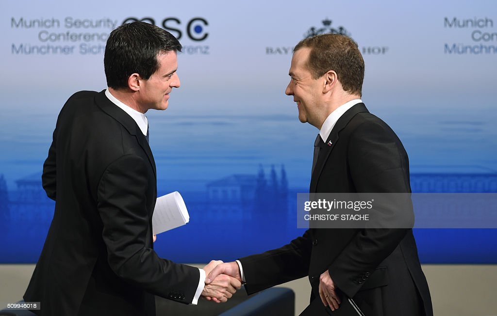 Russian Prime Minister Dmitry Medvedev (R) shakes hands with French Prime Minister Manuel Valls prior to a panel discussion at the second day of the 52nd Munich Security Conference (MSC) in Munich, southern Germany, on February 13, 2016. / AFP / Christof STACHE