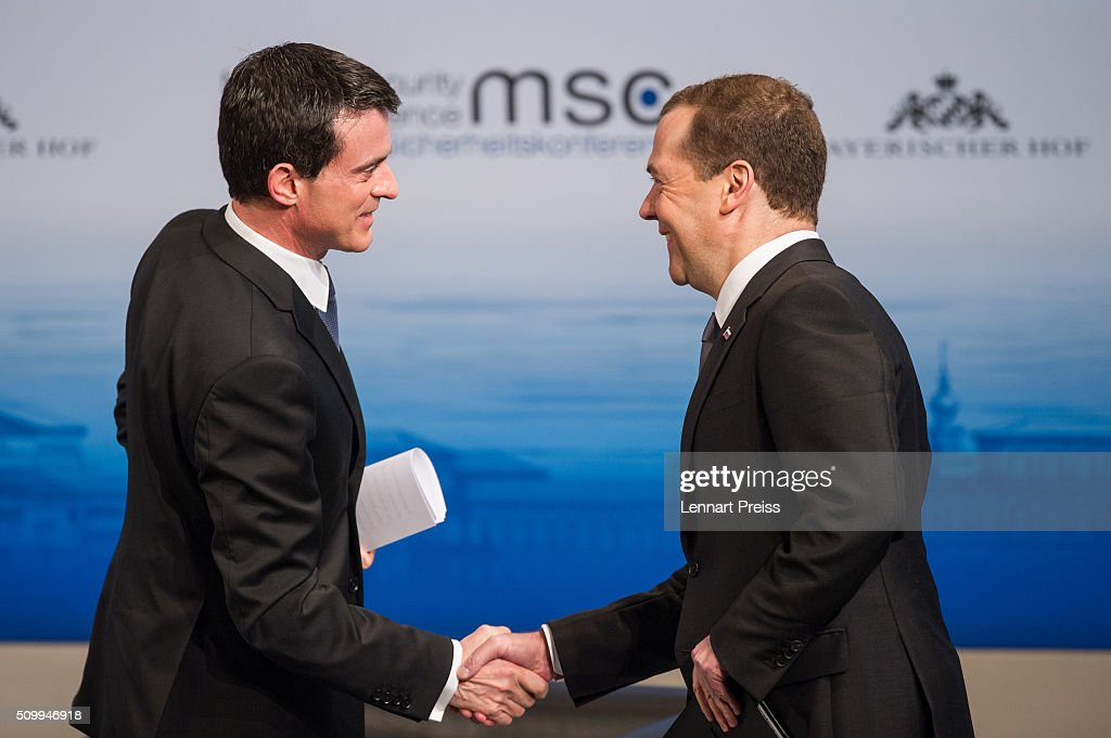 Russian Prime Minister <a gi-track='captionPersonalityLinkClicked' href=/galleries/search?phrase=Dmitry+Medvedev&family=editorial&specificpeople=554704 ng-click='$event.stopPropagation()'>Dmitry Medvedev</a> (R) shakes hands with French Prime Minister <a gi-track='captionPersonalityLinkClicked' href=/galleries/search?phrase=Manuel+Valls&family=editorial&specificpeople=2178864 ng-click='$event.stopPropagation()'>Manuel Valls</a> at the 2016 Munich Security Conference at the Bayerischer Hof hotel on February 13, 2016 in Munich, Germany. The annual event brings together government representatives and security experts from across the globe and this year the conflict in Syria will be the main issue under discussion.