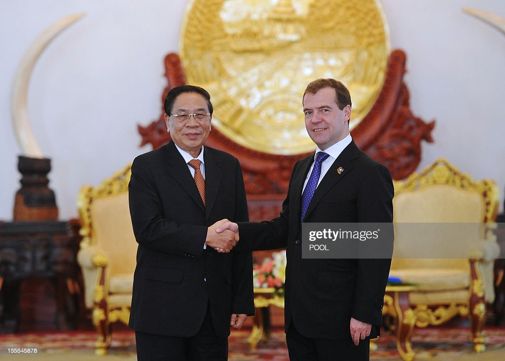 Russian Prime Minister Dmitry Medvedev (R) shakes hands with Laotian President Choummaly Sayasone during their meeting at the Presidential Palace in Vientiane, on November 5, 2012.