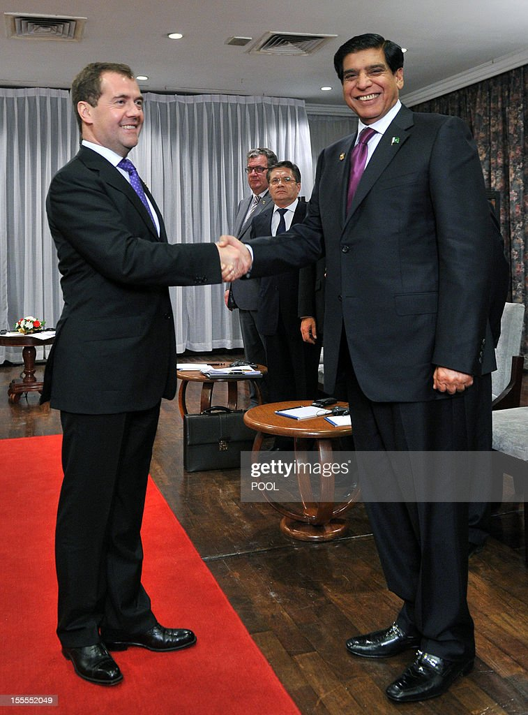 Russian Prime Minister Dmitry Medvedev (L) shakes hands with Pakistan's Prime Minister Raja Pervez Ashraf during the 9th Asia-Europe Meeting (ASEM) Summit in Vientiane, on November 5, 2012.