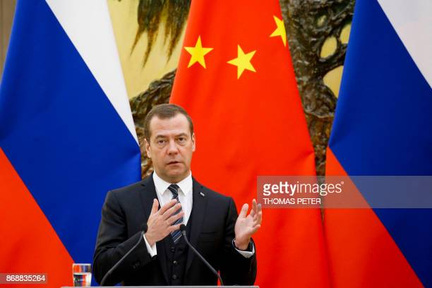 Russian Prime Minister Dmitry Medvedev speaks during a news conference after talks with Chinese Premier Li Keqiang at the Great Hall of the People in...