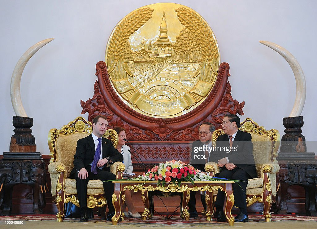 Russian Prime Minister Dmitry Medvedev (L) speaks with Laotian President Choummaly Sayasone during their meeting at the Presidential Palace in Vientiane, on November 5, 2012.