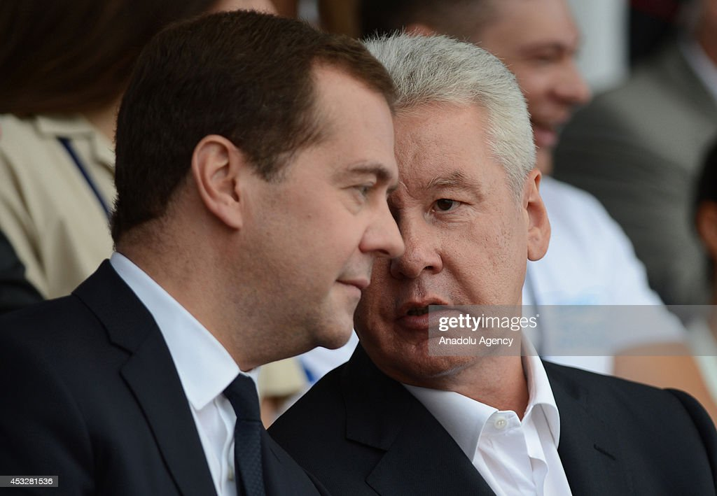 Russian Prime Minister Dmitry Medvedev (L) speaks with Moscow Mayor Sergey Sobyanin (R) during the opening ceremony of Canoe Sprint World Championships (ICF) 2014 in Moscow, Russia on August 6, 2014.
