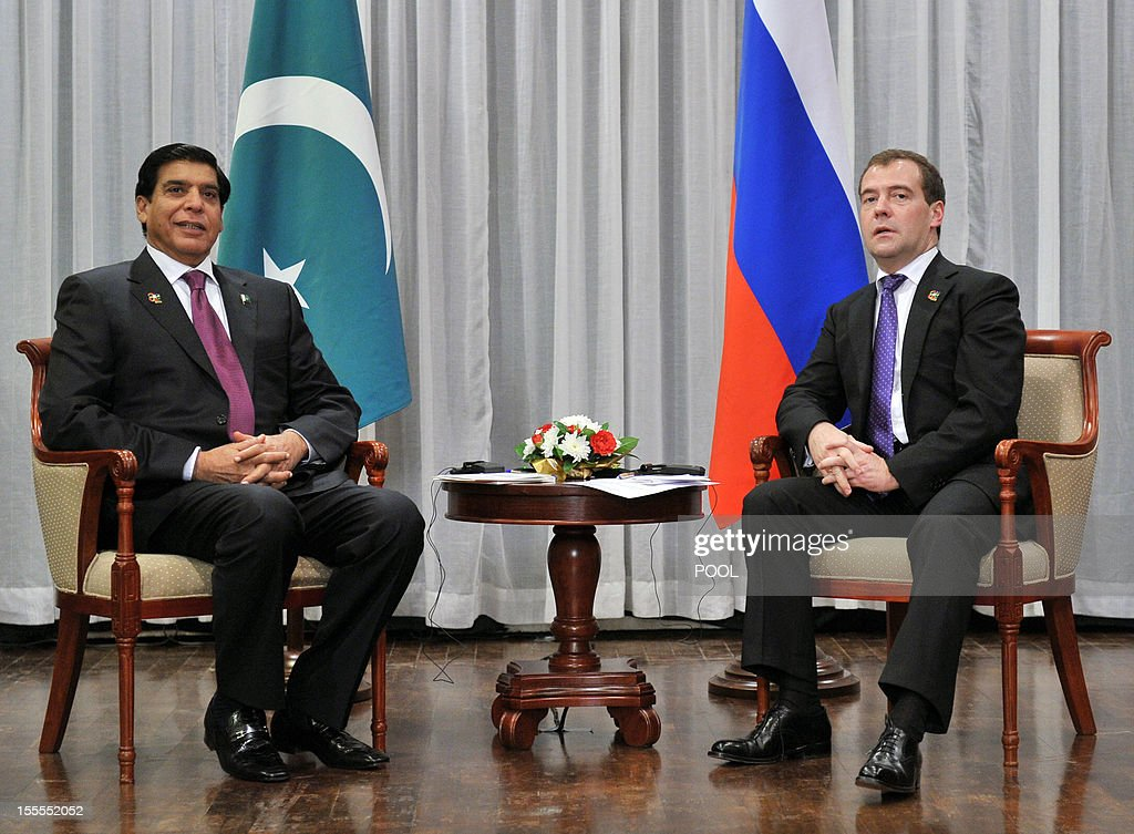 Russian Prime Minister Dmitry Medvedev (R) speaks with Pakistan's Prime Minister Raja Pervez Ashraf during the 9th Asia-Europe Meeting (ASEM) Summit in Vientiane, on November 5, 2012.