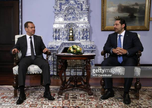 Russian Prime Minister Dmitry Medvedev speaks with Prime Minister of Lebanon Saad Hariri prior to a meeting in the country residence outside Moscow...