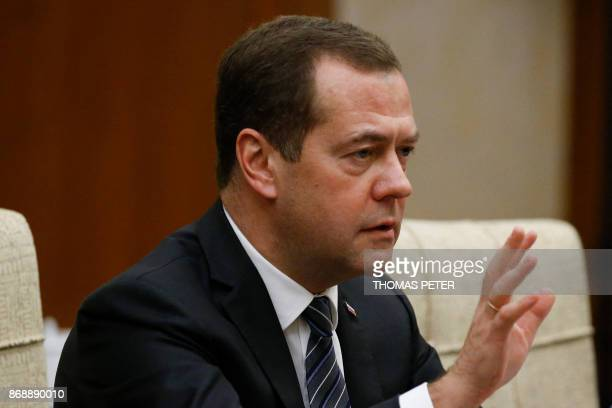 Russian Prime Minister Dmitry Medvedev talks during a meeting with Chinese President Xi Jinping at the Diaoyutai state guesthouse in Beijing on...