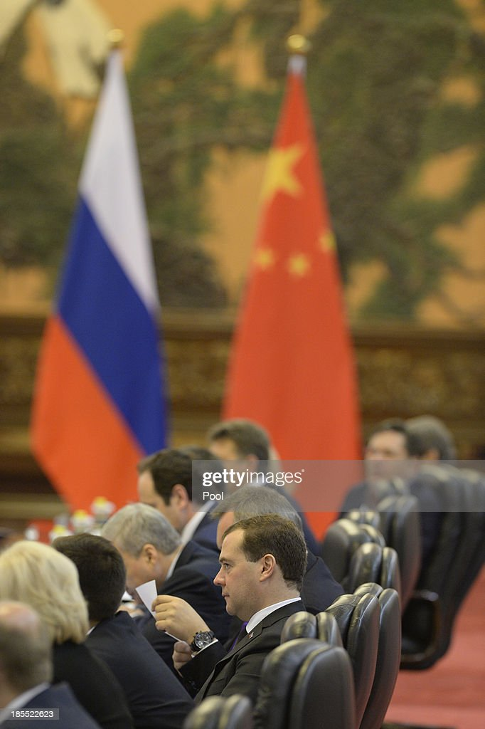 Russian Prime Minister Dmitry Medvedev talks with Chinese Premier Li Keqiang during their meeting at the Great Hall of the People on October 22, 2013 in Beijing, China. Medvedev is in China on a two-day visit as a guest of Chinese Premier Li Keqiang to co-chair the 18th regular meeting between the Chinese and Russian heads of government.