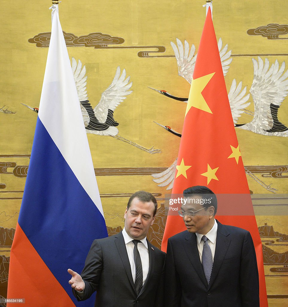 Russian Prime Minister <a gi-track='captionPersonalityLinkClicked' href=/galleries/search?phrase=Dmitry+Medvedev&family=editorial&specificpeople=554704 ng-click='$event.stopPropagation()'>Dmitry Medvedev</a> talks with Chinese Premier <a gi-track='captionPersonalityLinkClicked' href=/galleries/search?phrase=Li+Keqiang&family=editorial&specificpeople=2481781 ng-click='$event.stopPropagation()'>Li Keqiang</a> during a signing ceremony at the Great Hall of the People on October 22, 2013 in Beijing, China. Medvedev is in China on a two-day visit as a guest of Chinese Premier <a gi-track='captionPersonalityLinkClicked' href=/galleries/search?phrase=Li+Keqiang&family=editorial&specificpeople=2481781 ng-click='$event.stopPropagation()'>Li Keqiang</a> to co-chair the 18th regular meeting between the Chinese and Russian heads of government.