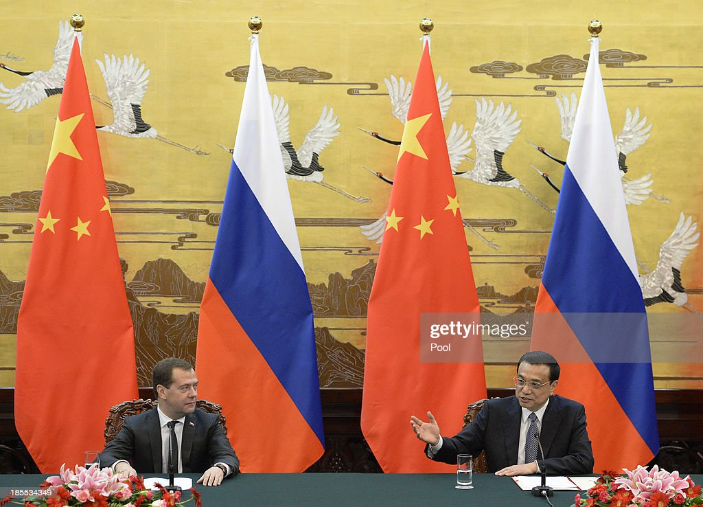 Russian Prime Minister <a gi-track='captionPersonalityLinkClicked' href=/galleries/search?phrase=Dmitry+Medvedev&family=editorial&specificpeople=554704 ng-click='$event.stopPropagation()'>Dmitry Medvedev</a> talks with Chinese Premier <a gi-track='captionPersonalityLinkClicked' href=/galleries/search?phrase=Li+Keqiang&family=editorial&specificpeople=2481781 ng-click='$event.stopPropagation()'>Li Keqiang</a> during a press briefing at the Great Hall of the People on October 22, 2013 in Beijing, China. Medvedev is in China on a two-day visit as a guest of Chinese Premier <a gi-track='captionPersonalityLinkClicked' href=/galleries/search?phrase=Li+Keqiang&family=editorial&specificpeople=2481781 ng-click='$event.stopPropagation()'>Li Keqiang</a> to co-chair the 18th regular meeting between the Chinese and Russian heads of government.
