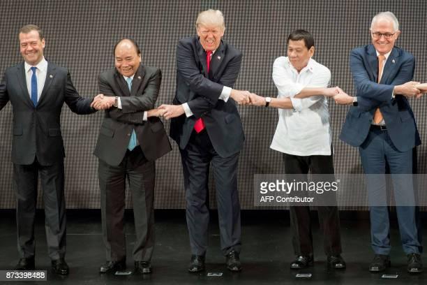 Russian Prime Minister Dmitry Medvedev Vietnam's Prime Minister Nguyen Xuan Phuc US President Donald Trump Philippine President Rodrigo Duterte and...