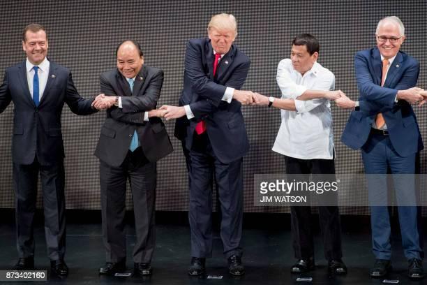 TOPSHOT Russian Prime Minister Dmitry Medvedev Vietnam's Prime Minister Nguyen Xuan Phuc US President Donald Trump Philippine President Rodrigo...