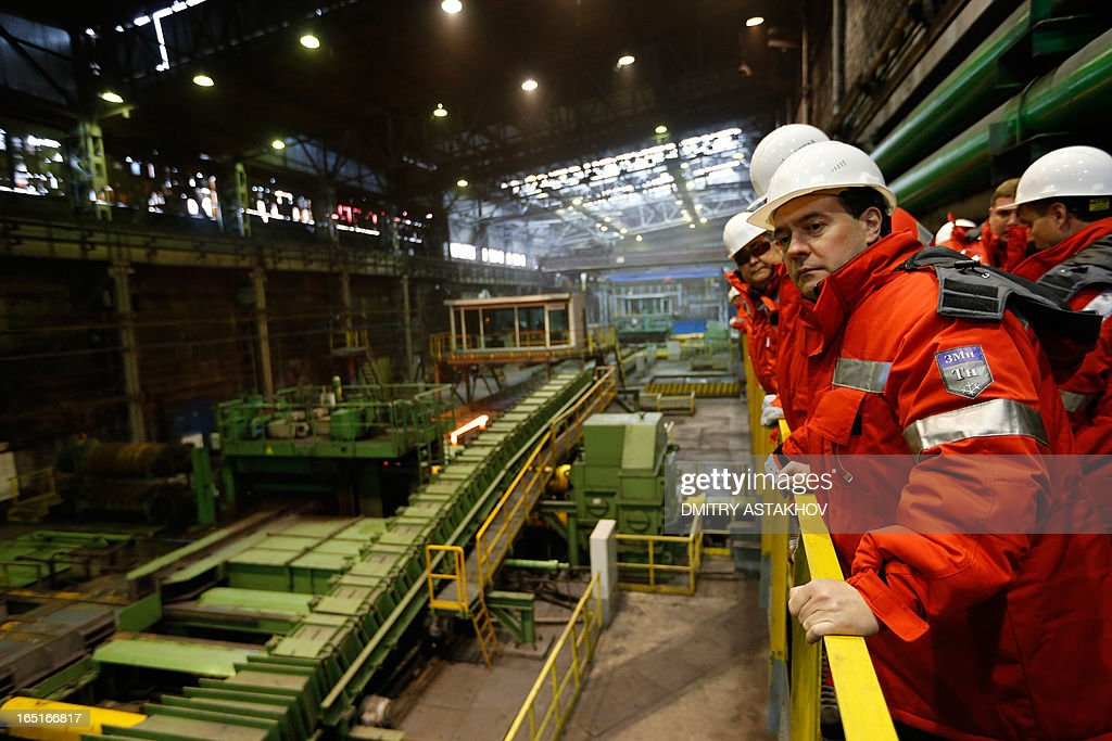 Russian Prime Minister Dmitry Medvedev visits of the rail and beam shop of Evraz, Russia's largest steelmaker, in the Siberian city of Novokuznetsk, on April 1, 2013.