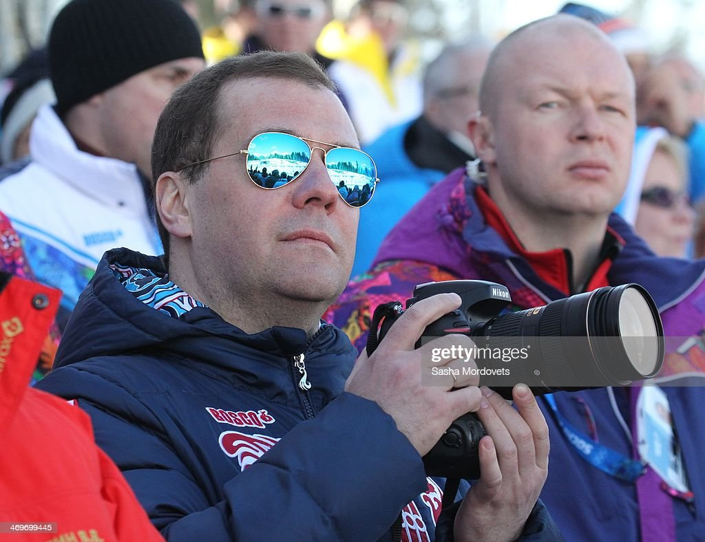 Russian Prime Minister Dmitry Medvedev watches the men's 4x10 K cross-country relay at the 2014 Winter Olympics, on February 16, 2014 in Krasnaya Polyana, Sochi, Russia. Putin and Medvedev are spending the weekend together in Sochi.