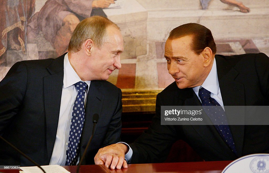 Russian Prime Minister <a gi-track='captionPersonalityLinkClicked' href=/galleries/search?phrase=Vladimir+Putin&family=editorial&specificpeople=154896 ng-click='$event.stopPropagation()'>Vladimir Putin</a> (L) and Italian Prime Minister <a gi-track='captionPersonalityLinkClicked' href=/galleries/search?phrase=Silvio+Berlusconi&family=editorial&specificpeople=201842 ng-click='$event.stopPropagation()'>Silvio Berlusconi</a> (R) attend a press conference held at Villa Gernetto on April 26, 2010 in Lesmo, Italy. The meeting between the two leaders will focus on bilateral economic issues, including cooperation between energy giants ENI of Italy and Gazprom of Russia.