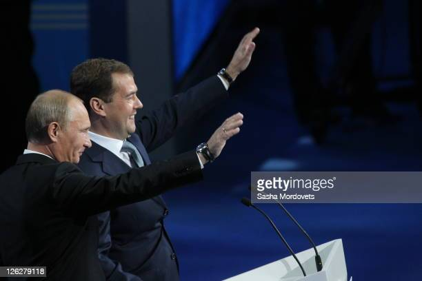 Russian Prime Minister Vladimir Putin and President Dmitry Medvedev participate in the United Russia Party congress on September 24 2011 in Moscow...