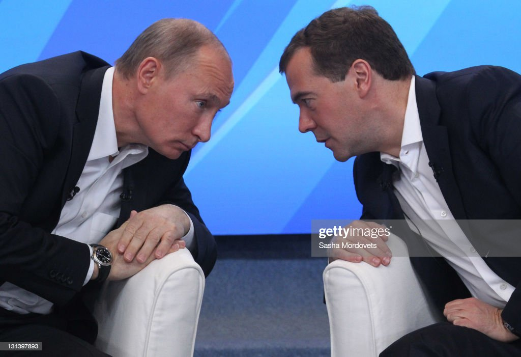 Russian Prime Minister Vladimir Putin (L) and President <a gi-track='captionPersonalityLinkClicked' href=/galleries/search?phrase=Dmitry+Medvedev&family=editorial&specificpeople=554704 ng-click='$event.stopPropagation()'>Dmitry Medvedev</a> meet their supporters on December 1, 2011 in Moscow, Russia. The meeting is the last prior to the State Duma elections planned on December4.