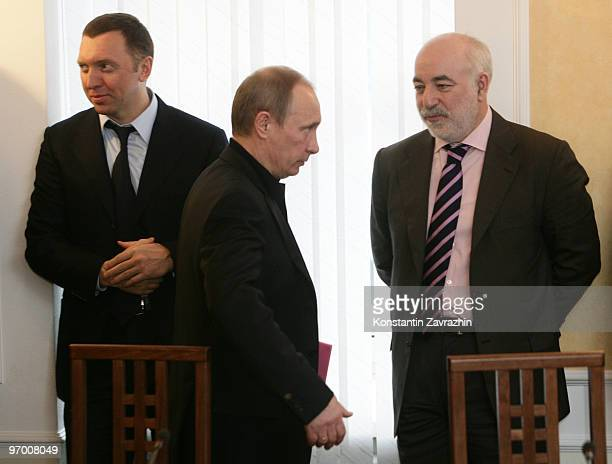 Russian Prime Minister Vladimir Putin arrives as Russian businessman Oleg Deripaska and finance minister Viktor Vekselberg look on as they visits...