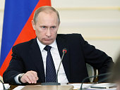 Russian Prime Minister Vladimir Putin attends a meeting outside Moscow in NovoOgarevo on March 31 2010 Putin said the latest attack in the North...