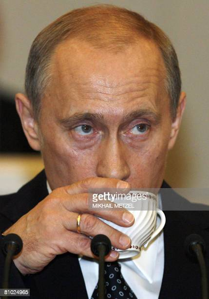 Russian Prime Minister Vladimir Putin drinks tea as he addresses the State Duma at the State Duma lower parliament chamber in Moscow on May 8 2008...