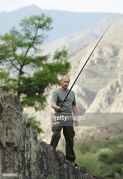 Russian Prime Minister Vladimir Putin fishes during his vacation outside the town of Kyzyl in Southern Siberia on August 3 2009 AFP PHOTO /...