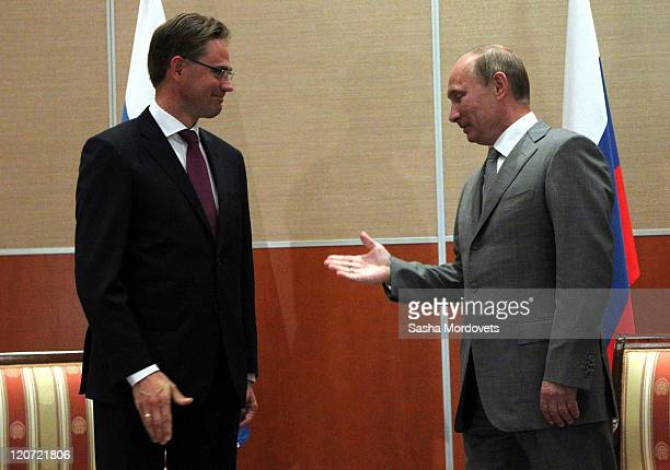 Russian Prime Minister Vladimir Putin greets Finland's Prime Minister Jyrki Katainen on August 9 2011 in Sochi Russia On the first day of a 2day...