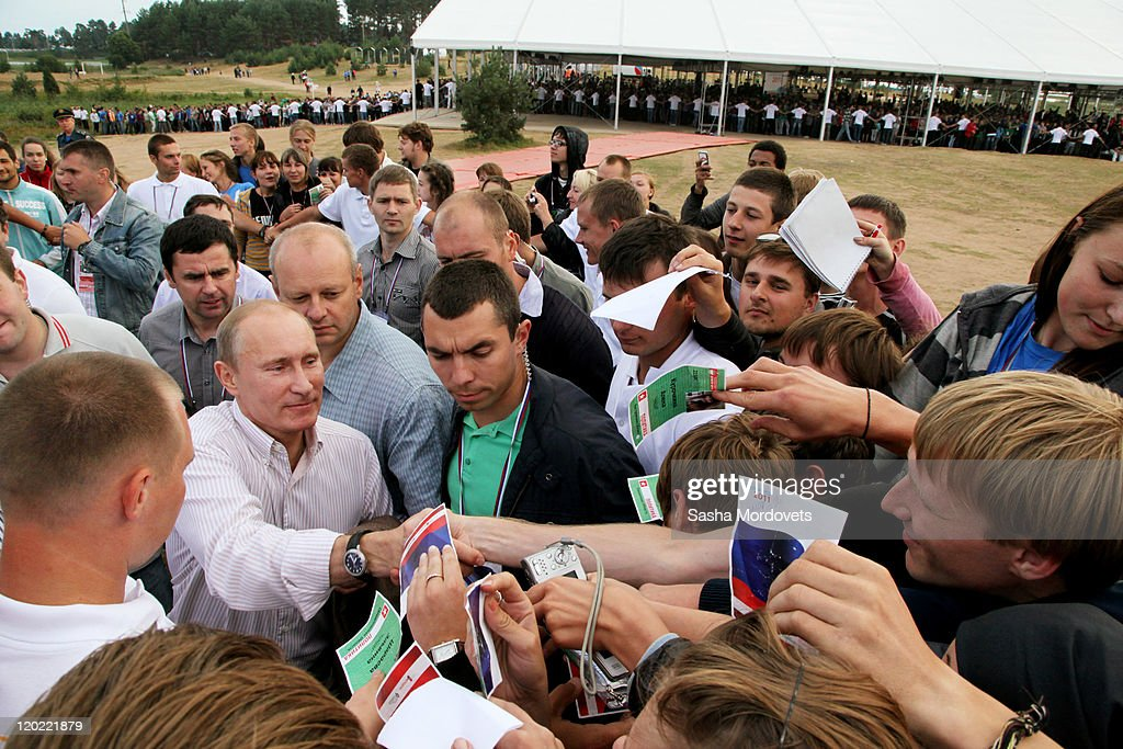 Russian Prime Minister <a gi-track='captionPersonalityLinkClicked' href=/galleries/search?phrase=Vladimir+Putin&family=editorial&specificpeople=154896 ng-click='$event.stopPropagation()'>Vladimir Putin</a> greets supporters at the Seliger educational youth forum August 1, 2011 at Lake Seliger, Tver Region, Russia, on August, 1, 2011. Putin commented on the unification of Russia and Belarus stating that it fully depends 'on the will of the Belarusian people.'