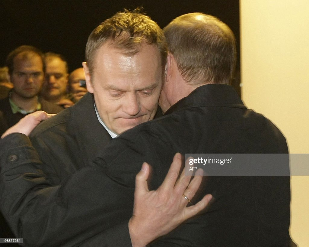 Russian Prime Minister Vladimir Putin hugs his Polish counterpart Donald Tusk as they visit the site of a Polish government Tupolev Tu154 aircraft...