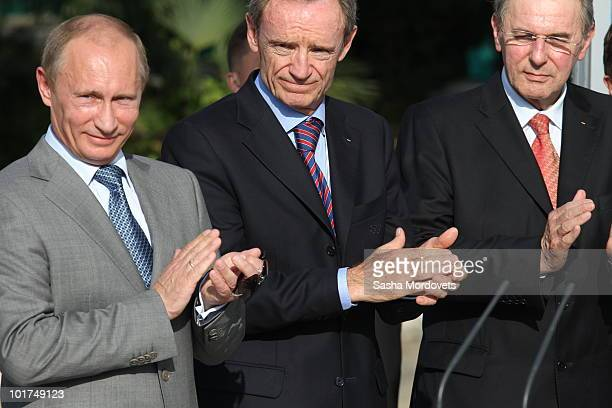 Russian Prime Minister Vladimir Putin JeanClaude Killy chairman of the Sochi2014 International Olympic Committee Assessment Commission and IOC chief...