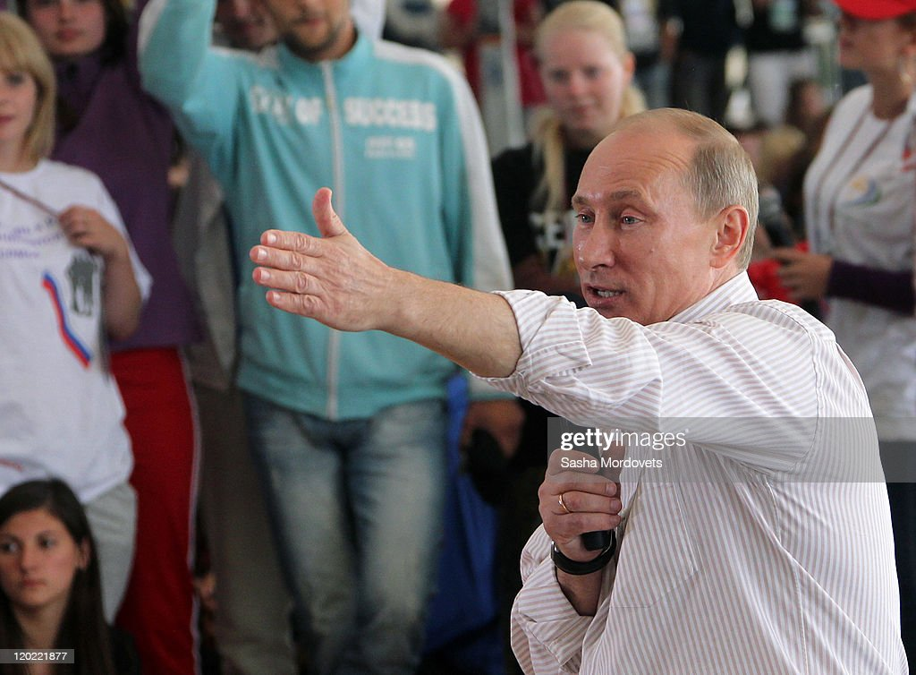 Russian Prime Minister <a gi-track='captionPersonalityLinkClicked' href=/galleries/search?phrase=Vladimir+Putin&family=editorial&specificpeople=154896 ng-click='$event.stopPropagation()'>Vladimir Putin</a> meets with supporters at the Seliger educational youth forum August 1, 2011 at Lake Seliger, Tver Region, Russia, on August, 1, 2011. Putin commented on the unification of Russia and Belarus stating that it fully depends 'on the will of the Belarusian people.'