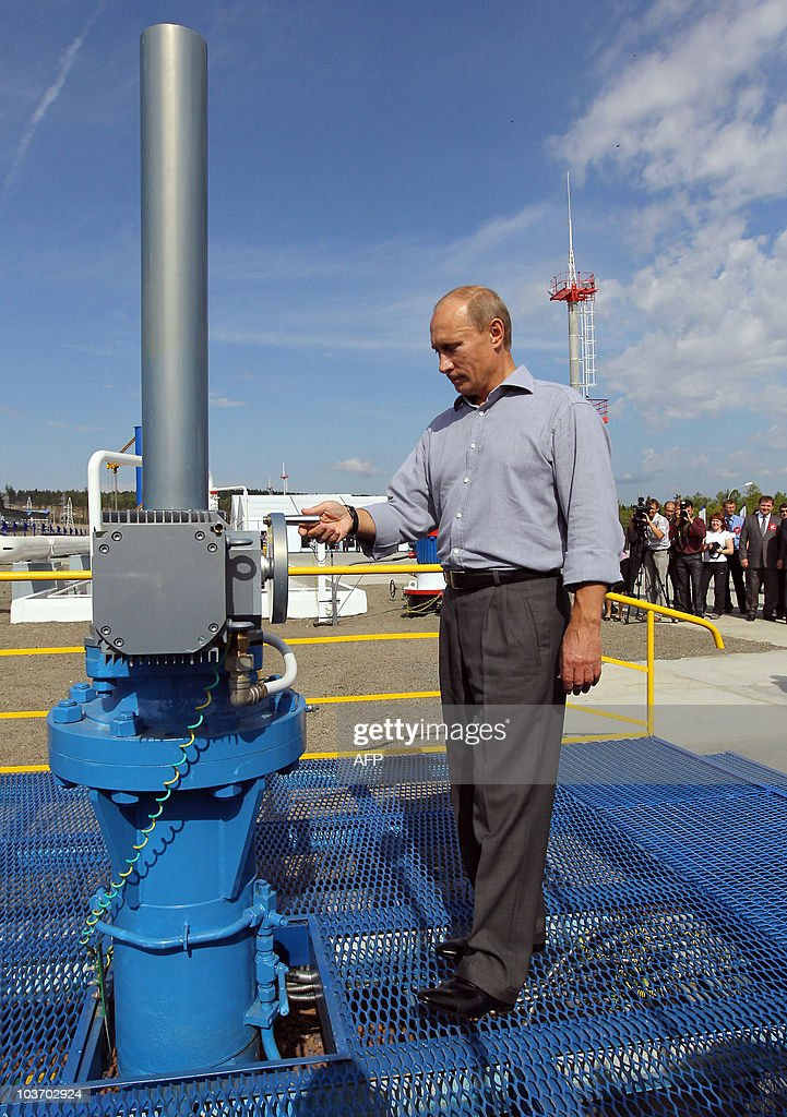 Russian Prime Minister Vladimir Putin opens a throttle during the opening ceremony for the Russian section of the Russia-China oil pipeline in the far eastern region of Amur on August 29, 2010.