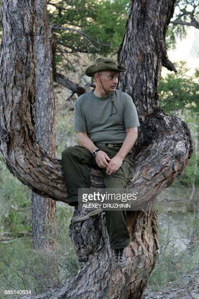 Russian Prime Minister Vladimir Putin poses during his vacation outside the town of Kyzyl in Southern Siberia on August 3 2009 AFP PHOTO / RIANOVOSTI...