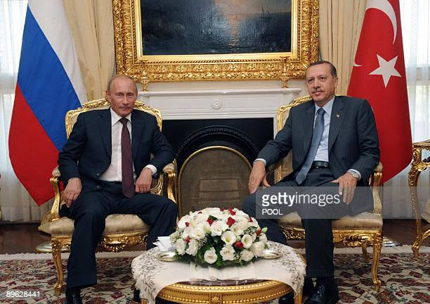 Russian Prime Minister Vladimir Putin poses with his Turkish counterpart Recep Tayyip Erdogan during a meeting in Ankara on August 6 2009 Russian...
