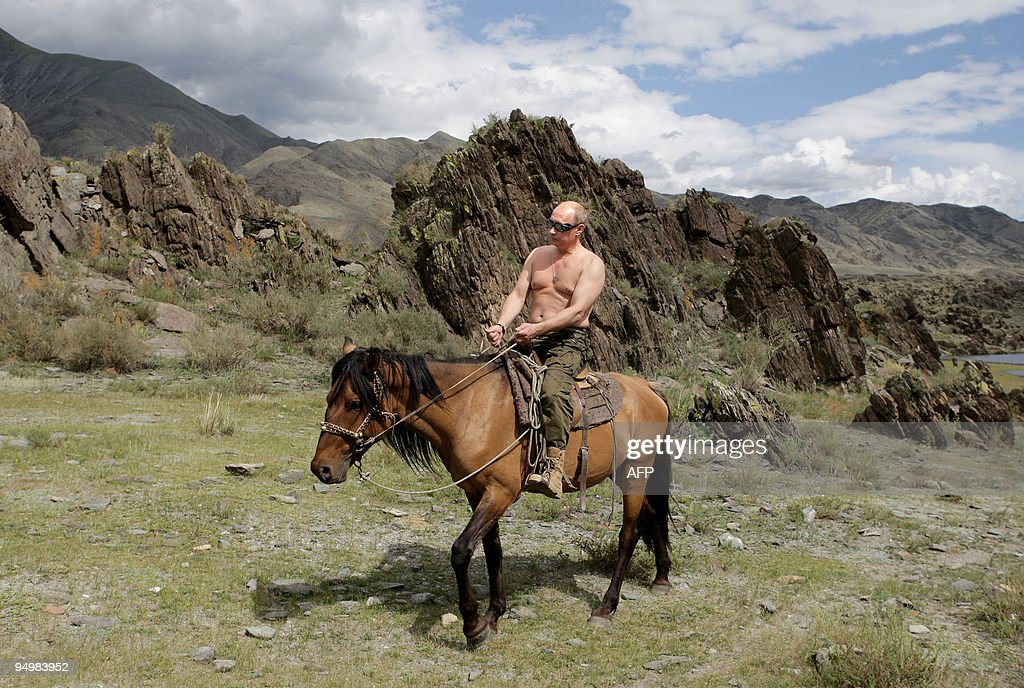 Russian Prime Minister <a gi-track='captionPersonalityLinkClicked' href=/galleries/search?phrase=Vladimir+Putin&family=editorial&specificpeople=154896 ng-click='$event.stopPropagation()'>Vladimir Putin</a> rides a horse during his vacation outside the town of Kyzyl in Southern Siberia on August 3, 2009. AFP PHOTO / RIA-NOVOSTI / ALEXEY DRUZHININ