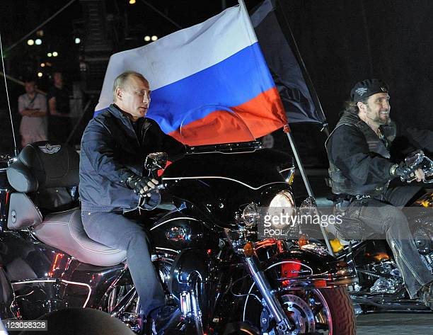 Russian Prime Minister Vladimir Putin rides a motorbike as he takes part in the 16th annual motorbike festival held by 'The Night Wolves' youth...