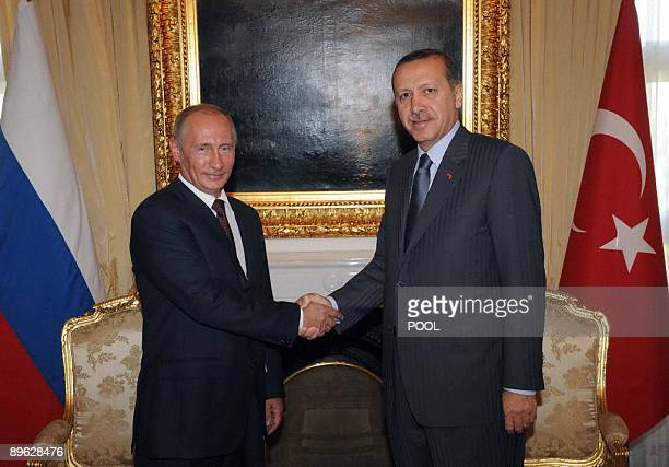 Russian Prime Minister Vladimir Putin shakes hands with his Turkish counterpart Recep Tayyip Erdogan during a meeting in Ankara on August 6 2009...
