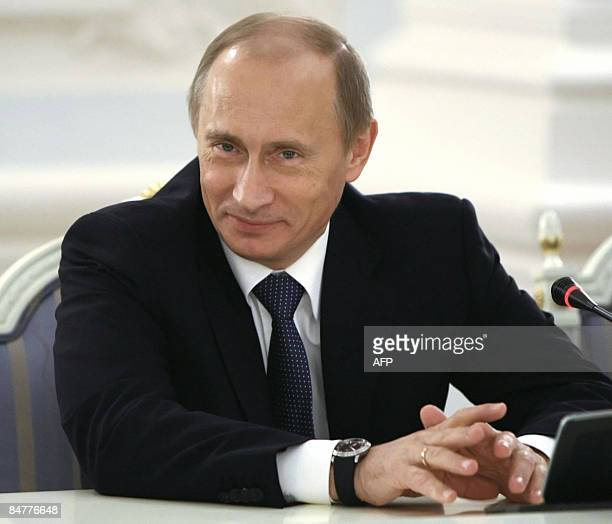 Russian Prime Minister Vladimir Putin smiles during his meeting withTurkish President Abdullah Gul in Moscow on February 13 2009 Medvedev welcomed...