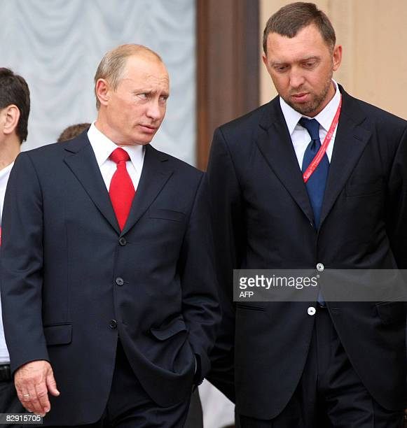 Russian Prime Minister Vladimir Putin speaks with Oleg Deripaska head of 'The base element' company at the International Investment Forum in Sochi on...