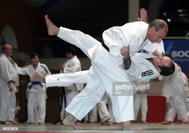 Russian Prime Minister Vladimir Putin takes part in a judo training session during his working visit to St Petersburg on December 18 2009 AFP PHOTO/...