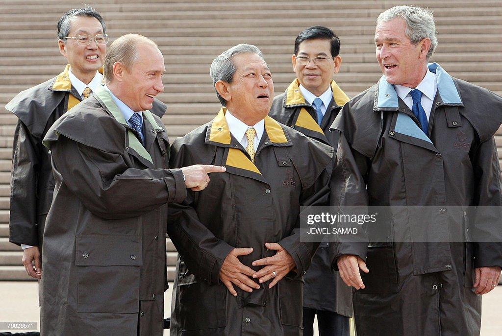 Russian Prime Minister Vladimir Putin Thai Prime Minister Surayud Chulanont and US President George W Bush enjoy a laugh as Taiwan's representative...