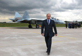 Russian Prime Minister Vladimir Putin walks near a new Russian fighter jet Sukhoi T50 after its flight in Zhukovksy outside Moscow on June 17 2010...