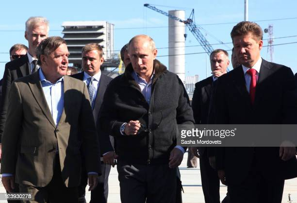 Russian Prime Minister Vladimir Putin walks with Chairman of the Shareholders' Committee at Nord Stream Gerhard Schroeder and Gazprom CEO Alexey...