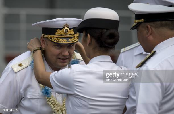 Russian Rear Admiral Edward Mikhailov is welcomed by Philippine Navy personnel as he arrives at the port of Manila on October 20 2017 Three Russian...