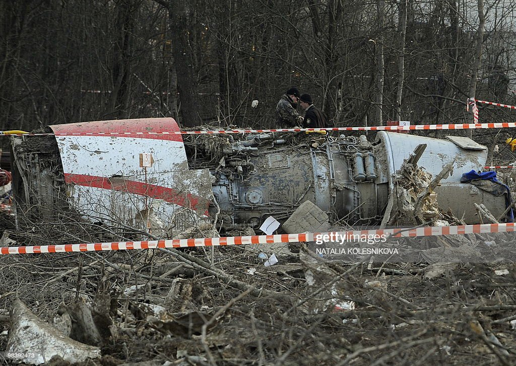 Russian rescuers inspect on April 11 2010 the wreckage of a Polish government Tupolev Tu154 aircraft which crashed on April 10 near Smolensk airport...