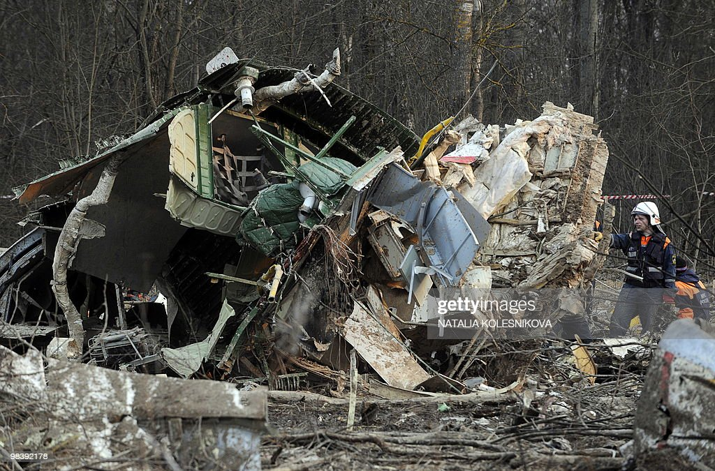 Russian rescuers inspect the wreckage of a Polish government Tupolev Tu154 aircraft which crashed on April 10 near Smolensk airport on April 11 2010...